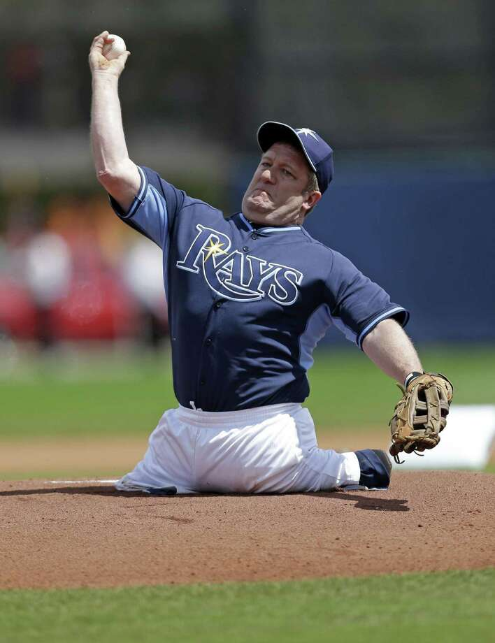 Dave Stevens, of Bristol, Conn., who was born without legs, throws out the first pitch before an exhibition baseball game between the Tampa Bay Rays and the Boston Red Sox in Port Charlotte, Fla., Tuesday, March 25, 2014. (AP Photo/Gerald Herbert) Photo: Gerald Herbert / Associated Press / AP