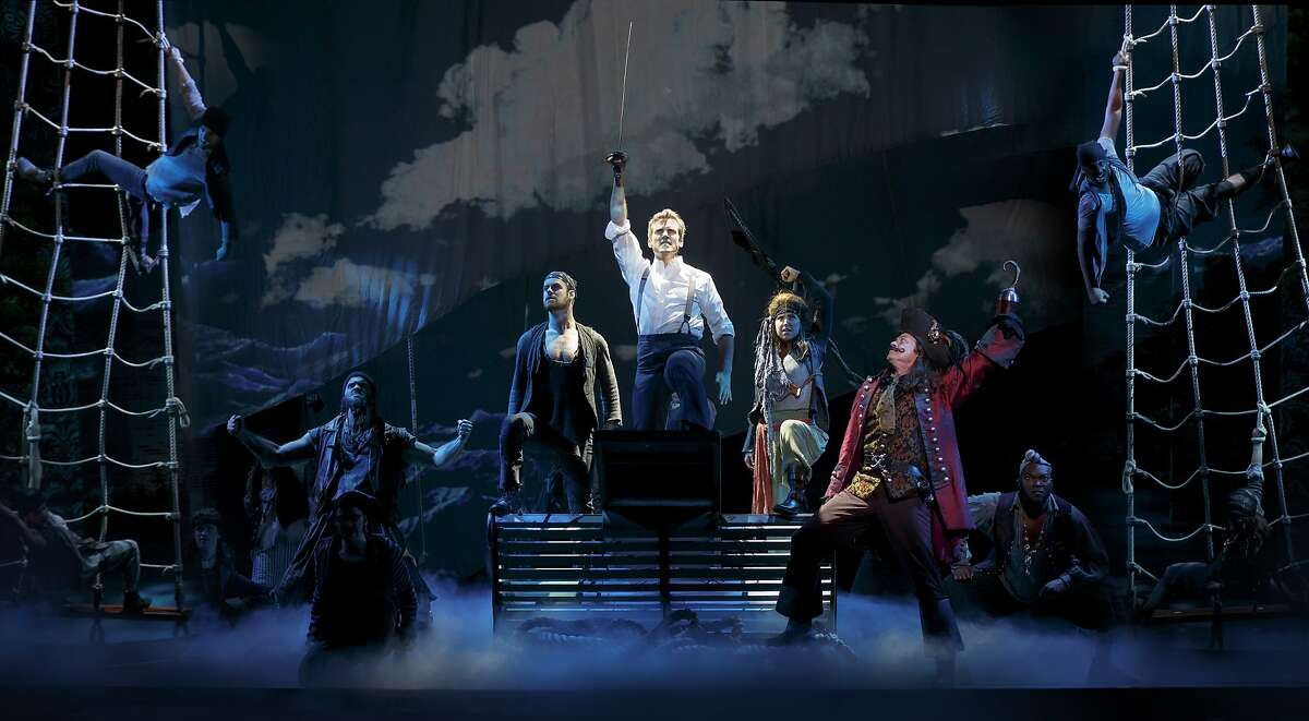 Dramatic staging and special effects conjure pirate ship around Kevin Kern as J.M. Barrie and Tom Hewitt as Captain Hook on the first national tour of �Finding Neverland.� Photo: Carol Rosegg.