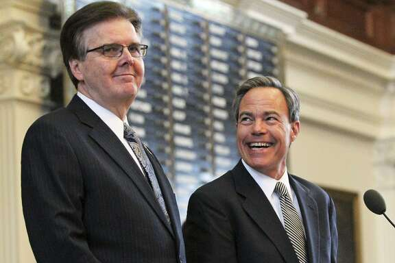 Lt. Gov. Dan Patrick and Speaker Joe Straus chat before Governor Greg Abbott delivers his State of the State address before a joint session of the Legislature held in the House of Representatives on February 17, 2015