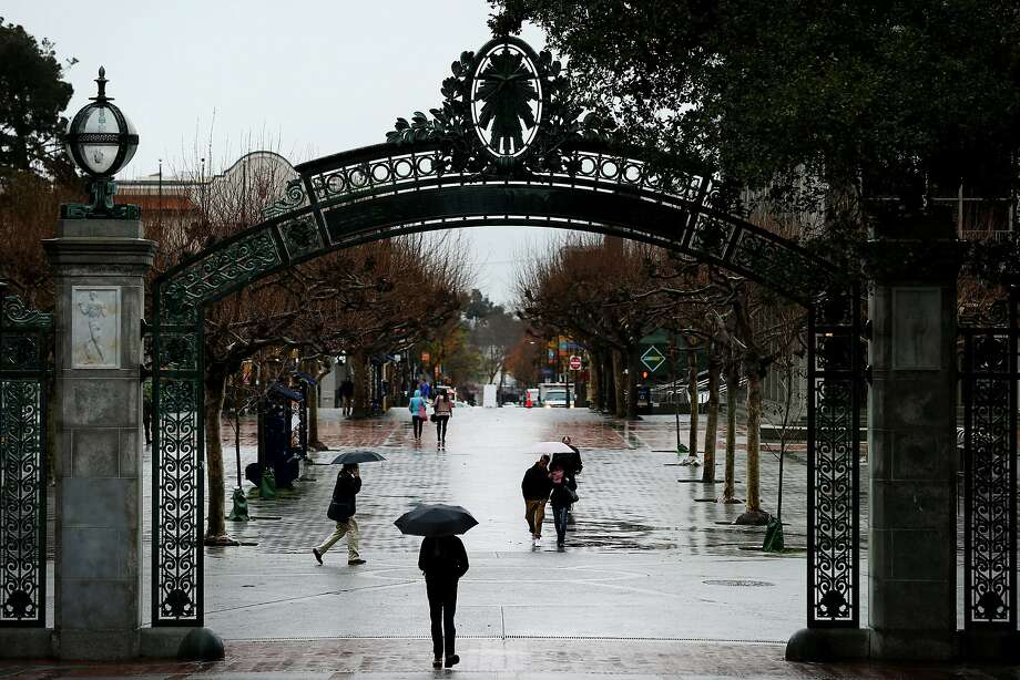 People make their way through Sather Gate during the rain at UC Berkeley on Jan. 4. The campus plans to build a gender-inclusive locker room, the first in the UC system, next year. Photo: Santiago Mejia, The Chronicle