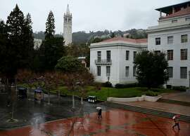 People make their way during a rainy day at UC Berkeley on Wednesday, Jan. 4, 2017 in Berkeley, Calif. Tuition at the University of California is expected to grow for the first time since 2011 under a proposal the UC regents will consider this month.