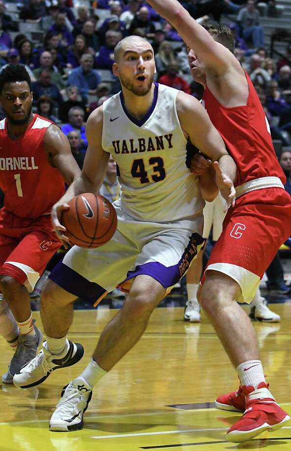 University at Albany's Greig Stire drives to the hoop during a basketball game against Cornell at the SEFCU Arena on Monday, Jan. 2, 2017 in Albany N.Y. (Lori Van Buren / Times Union) Photo: Lori Van Buren / 20038995A