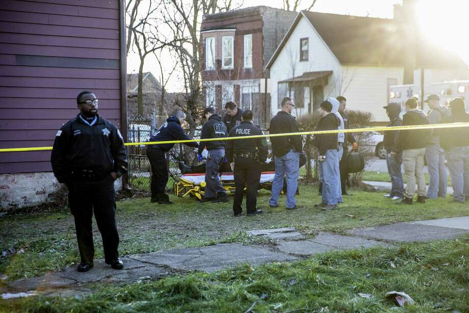 Members of the Chicago Fire Department transport a person who was shot near the intersection of South May Street and West 58th Street on Monday, Dec. 26, 2016 in Chicago, Ill. Photo: Armando L. Sanchez / TNS / Chicago Tribune