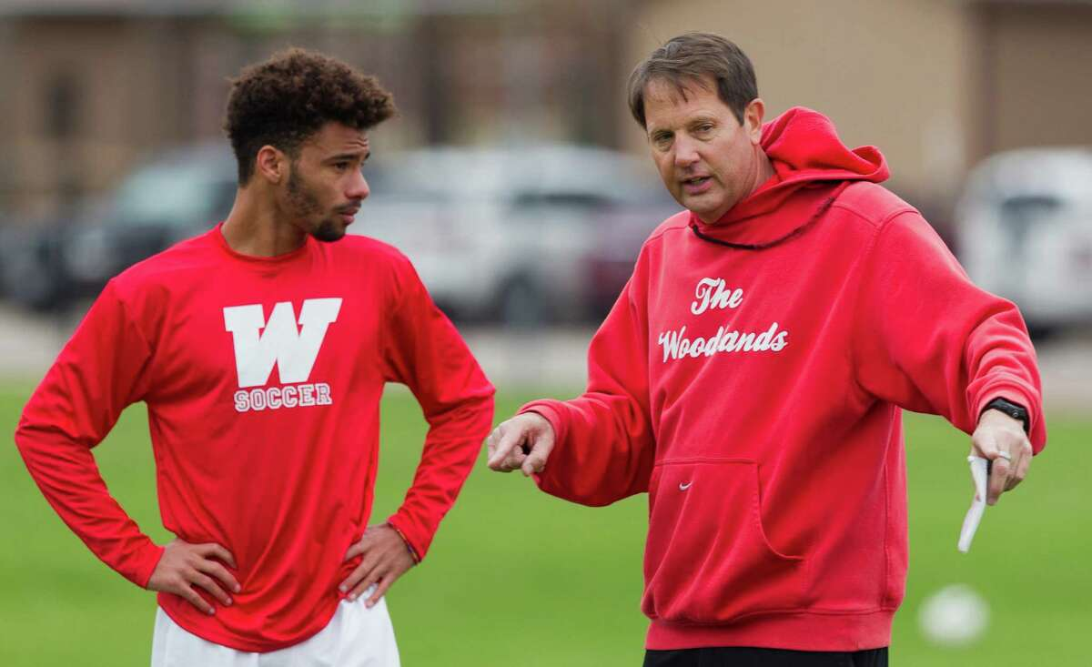 The Woodlands' Wesley Mitchell, left, talks with head coach Hans Kleinschmidt during boys soccer practice at The Woodlands High School Wednesday, Jan. 4, 2017, in The Woodlands. Mitchell was named the Montgomery County Newcomer of the Year as a junior last season after finishing with 18 goals and added 11 assists.