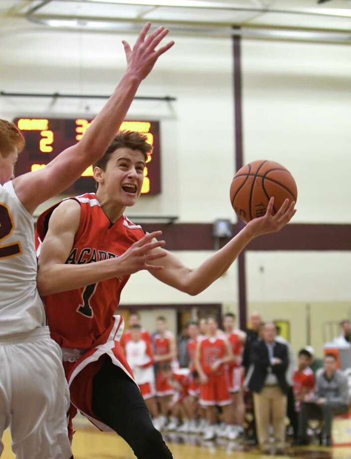 Albany Academy's August Mahoney drives to the basket during their high school basketball game against Colonie on Saturday Dec. 31, 2016 in Colonie, N.Y. (Michael P. Farrell/Times Union) Photo: Michael P. Farrell / 20039277A