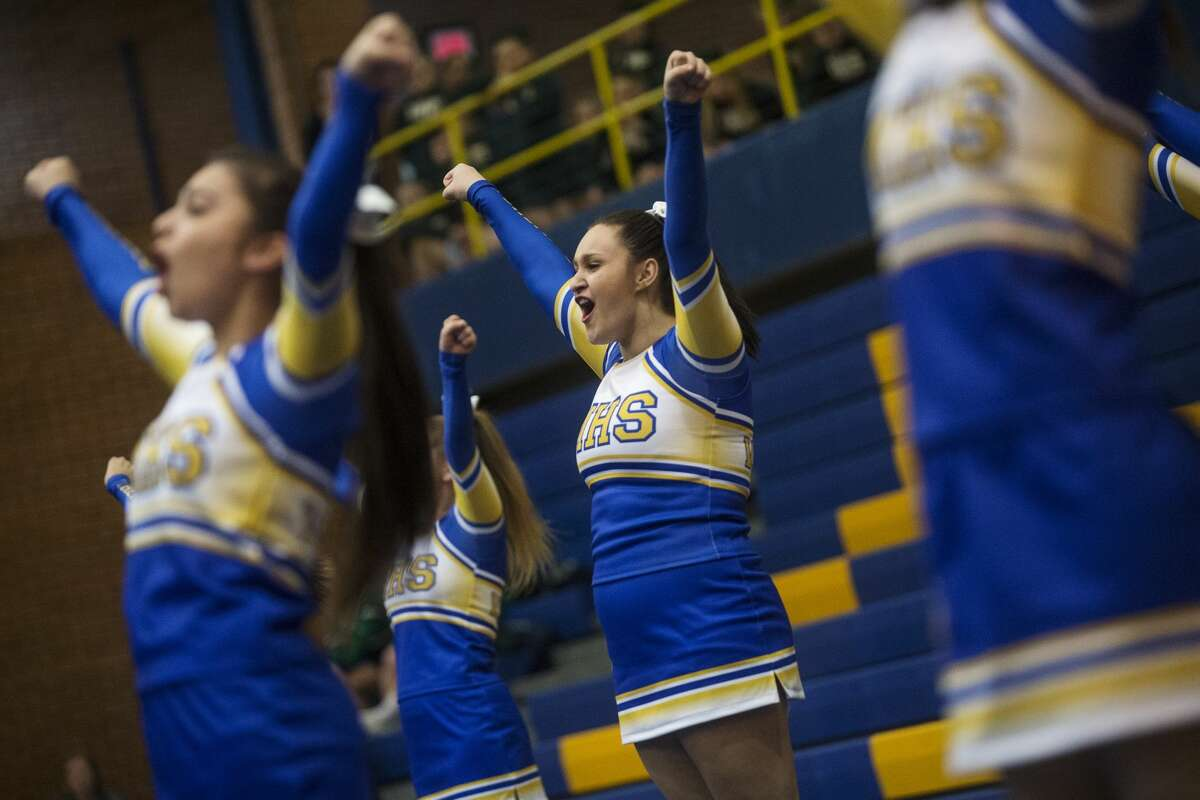 Midland Varsity Cheer senior Marissa Ramos, 17, competes in the Sixth Annual Chemic Cheer Invitational on Wednesday at Midland High School. Midland hosted Dow, Meridian, Saginaw Heritage, Vassar, Jefferson Middle School and Northeast Middle School at the competition.