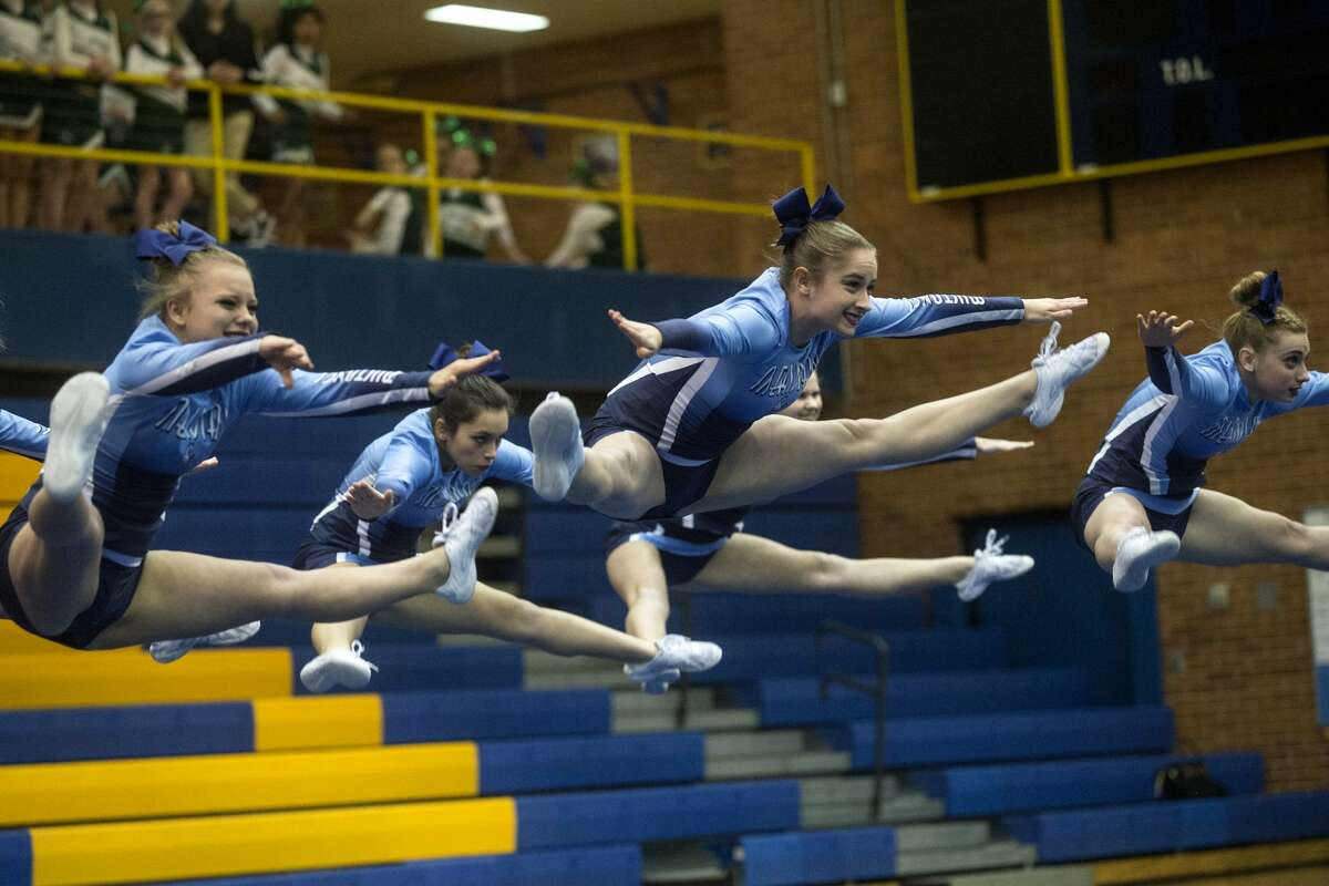 Meridian Cheer competes in the second round of the Sixth Annual Chemic Cheer Invitational on Wednesday at Midland High School. Midland High hosted Dow, Meridian, Bay City Central, Saginaw Heritage, Vassar Jefferson Middle School and Northeast Middle School at the competition.