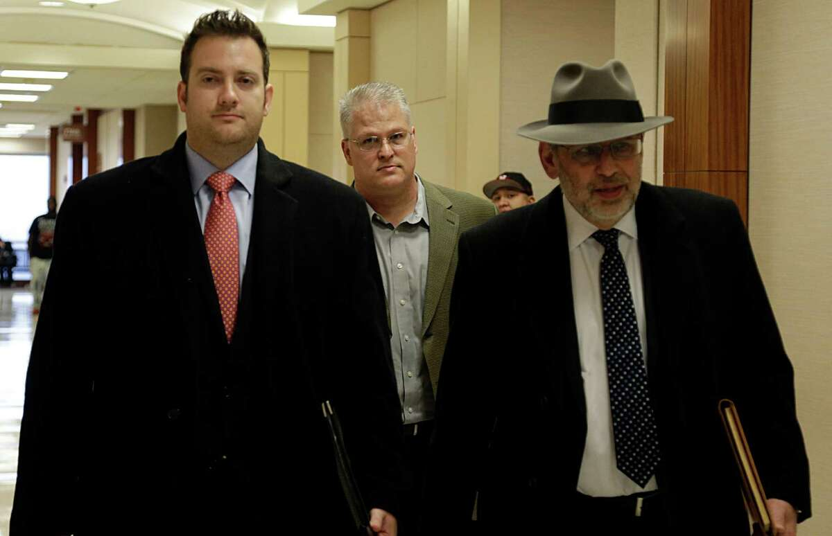 David Temple center, flanked by his attorneys, Romy Kaplan, left, and Stanley Schneider, want a court determination that he is actually innocent in the 1999 murder of his wife, Belinda Temple.