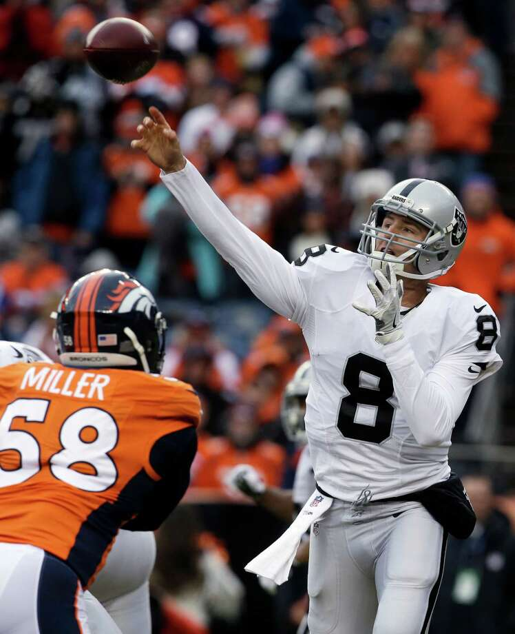 Oakland Raiders quarterback Connor Cook passes against the Denver Broncos during the first half of an NFL football game, Sunday, Jan. 1, 2017, in Denver. Cook came into the game after Raiders quarterback Matt McGloin was injured. (AP Photo/Joe Mahoney) ORG XMIT: COTW122 Photo: Joe Mahoney / FR170458 AP