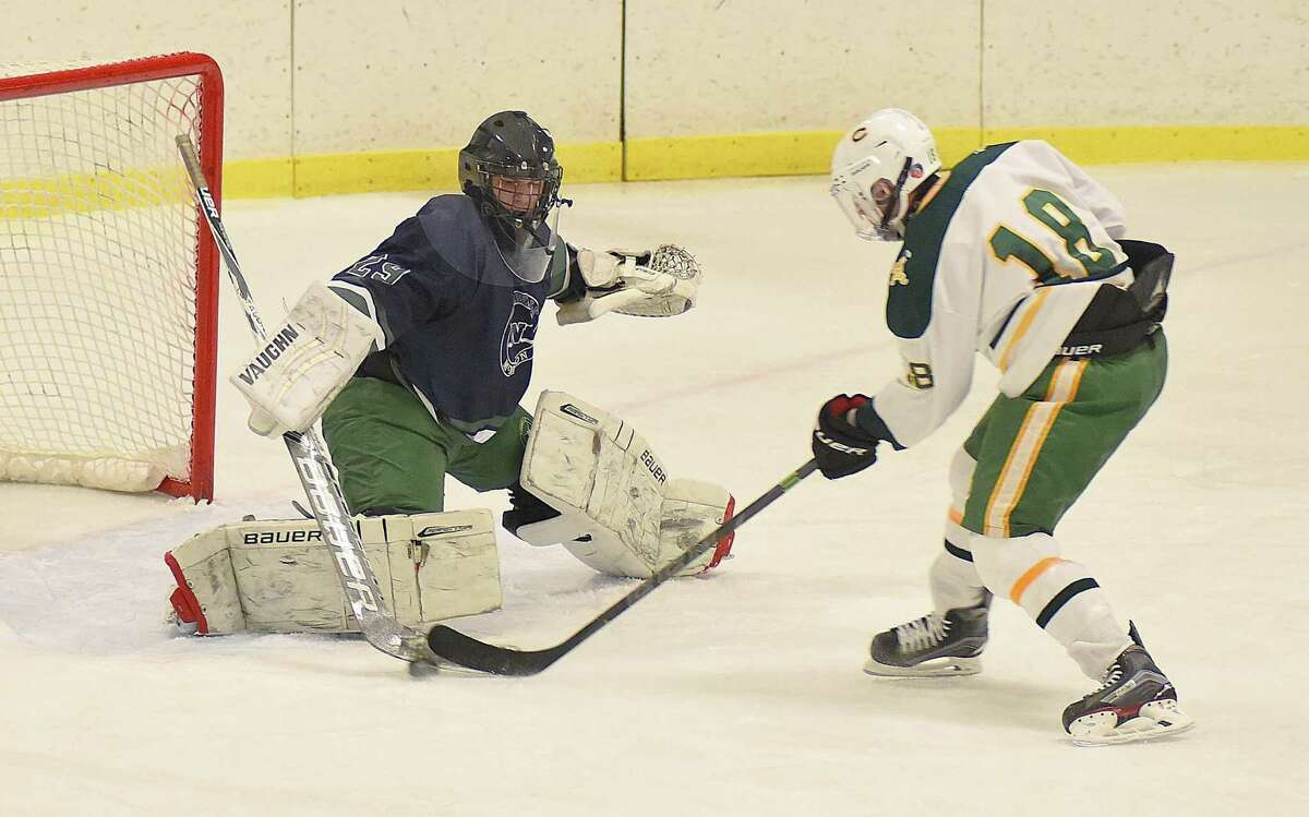 Norwalk-McMahon goaltender David Lamb makes one of his 26 saves by denying Trinity Catholic's Shane Haggerty this breakaway opportunity Wednesday.