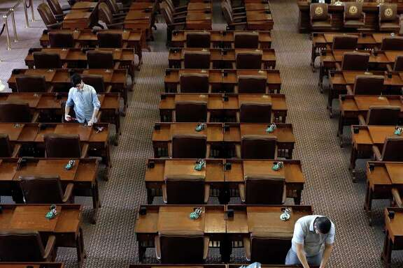 Works make upgrades to the voting panels in the House Chamber at the Texas Capitol, Wednesday, Jan. 4, 2017, in Austin, Texas. The 85th Texas Legislative session begins Jan. 10. (AP Photo/Eric Gay)