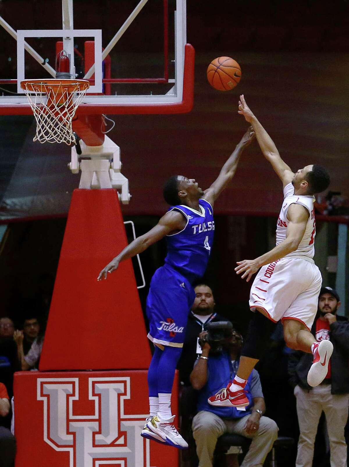 Tulsa Golden Hurricane guard Sterling Taplin (4) tries to block a shot from Houston Cougars guard Galen Robinson Jr. (25) during the second half of a basketball game at Hofheinz Pavilion, on the University of Houston campus, Wednesday, Jan. 4, 2017, in Houston.