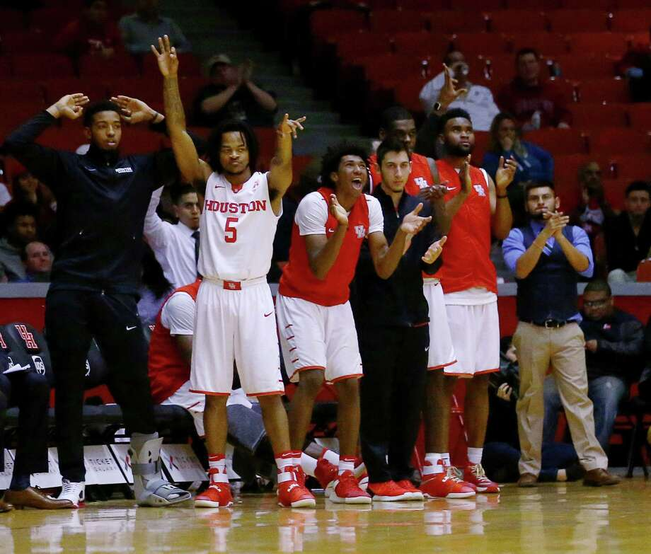 The Houston Cougars bench celebrates during the second half of a basketball game at Hofheinz Pavilion, on the University of Houston campus, Wednesday, Jan. 4, 2017, in Houston. Photo: Jon Shapley, Houston Chronicle / © 2015  Houston Chronicle