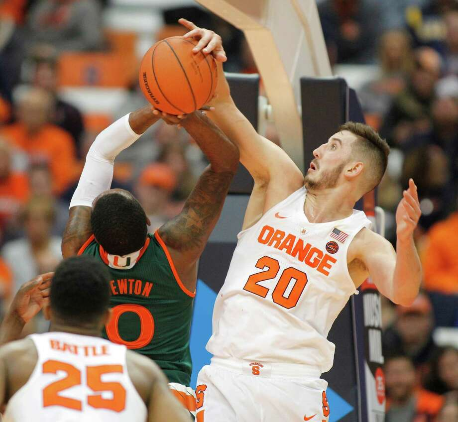 Syracuse's Tyler Lydon, right, blocks a shot from Miami's Ja'quan Newton, left, in the second half of an NCAA college basketball game in Syracuse, N.Y., Wednesday, Jan. 4, 2017. Syracuse won 70-55. (AP Photo/Nick Lisi) ORG XMIT: NYNL110 Photo: Nick Lisi / FR171024 AP