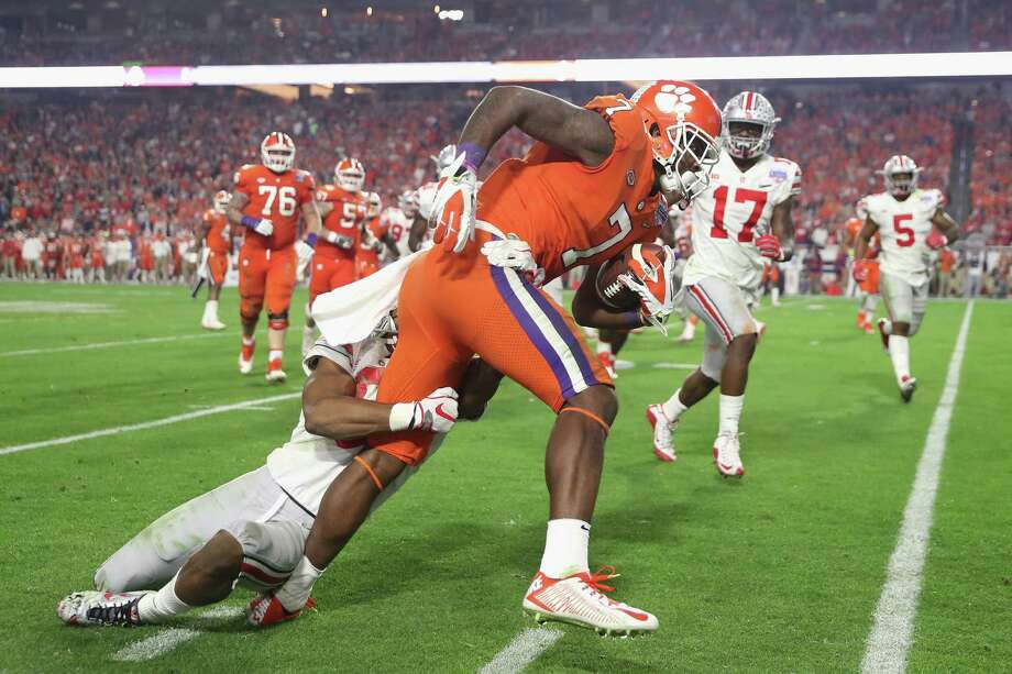 GLENDALE, AZ - DECEMBER 31:  Mike Williams #7 of the Clemson Tigers runs with the ball during the second half against the Ohio State Buckeyes during the 2016 PlayStation Fiesta Bowl at University of Phoenix Stadium on December 31, 2016 in Glendale, Arizona.  (Photo by Matthew Stockman/Getty Images) ORG XMIT: 686850767 Photo: Matthew Stockman / 2016 Getty Images