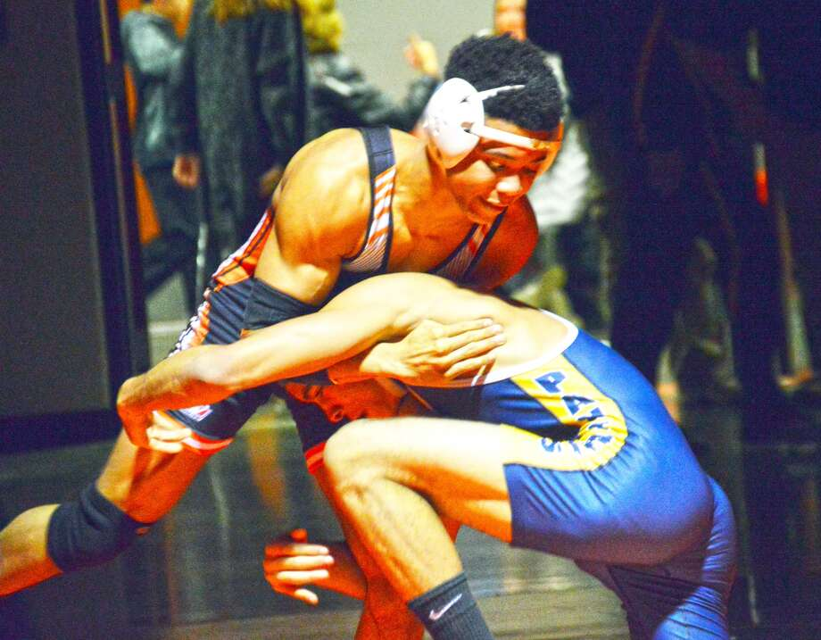 Edwardsville's Joe Griffin, top, grabs hold of O'Fallon's Jalen Jones before attempting a takedown in the second round of his 138-pound bout during Wednesday's dual meet at the Jon Davis Wrestling Center.