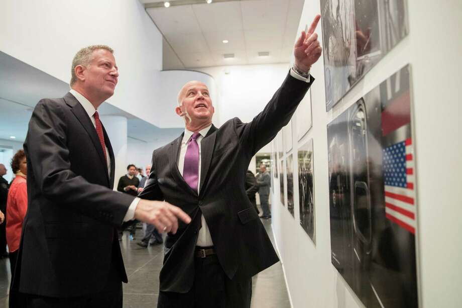 New York City Mayor Bill de Blasio, right, and NYPD Commissioner Jim O'Neil inspect an exhibit at the Brooklyn museum, Wednesday, Jan. 4, 2017, in New York. New York City recorded its fewest number of shootings last year and narrowly missed setting a record low for homicides. According to data released Wednesday, the city had 335 homicides in 2016. The city's record low was 333 in 2014. Police officials reported 998 shooting incidents in 2016. Overall crime was also at its lowest.(AP Photo/Mary Altaffer) ORG XMIT: NYMA103 Photo: Mary Altaffer / Copyright 2017 The Associated Press. All rights reserved.