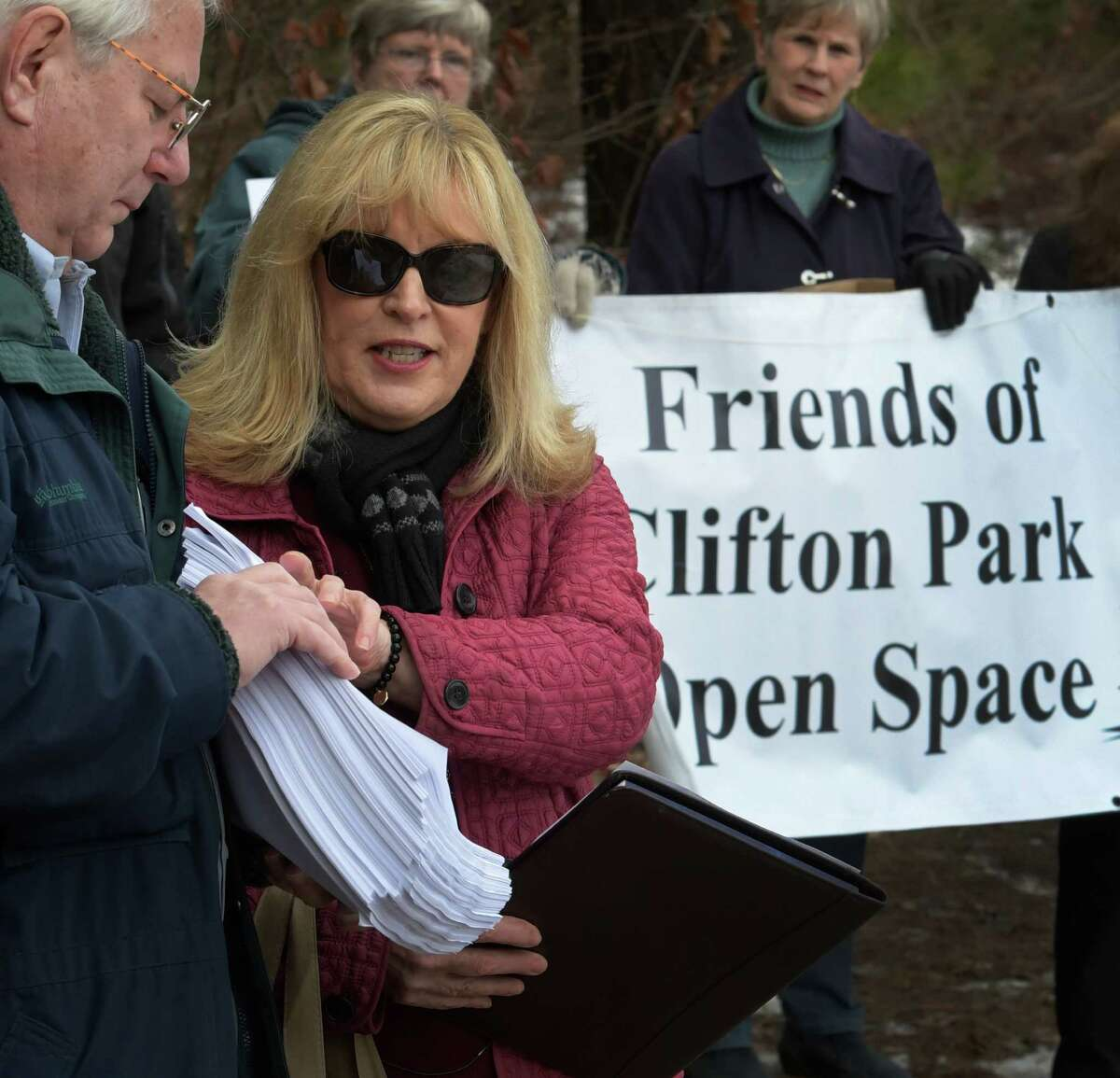 Susan Burton addresses the media as a representative of the Friends of Clifont Park Open Space Wednesday January 4, 2017 in Clifton Park, N.Y. Burton is joined by Dan Mathias who is holding the signed petitions that carry 7026 signatures forcing a referendum vote. (Skip Dickstein/Times Union)