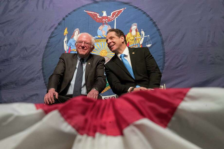 New York Gov. Andrew Cuomo, right, and Vermont Sen. Bernie Sanders appear onstage together during an event at LaGuardia Community College, Tuesday, Jan. 3, 2017, in New York. Gov. Cuomo announced a proposal for free tuition at state colleges to hundreds of thousands of low- and middle income residents. Under the governor's plan, which requires legislative approval, any college student accepted to a New York public university or two-year community college is eligible, provided their family earns less than $125,000. (AP Photo/Mary Altaffer) ORG XMIT: NYMA103 Photo: Mary Altaffer / Copyright 2017 The Associated Press. All rights reserved.