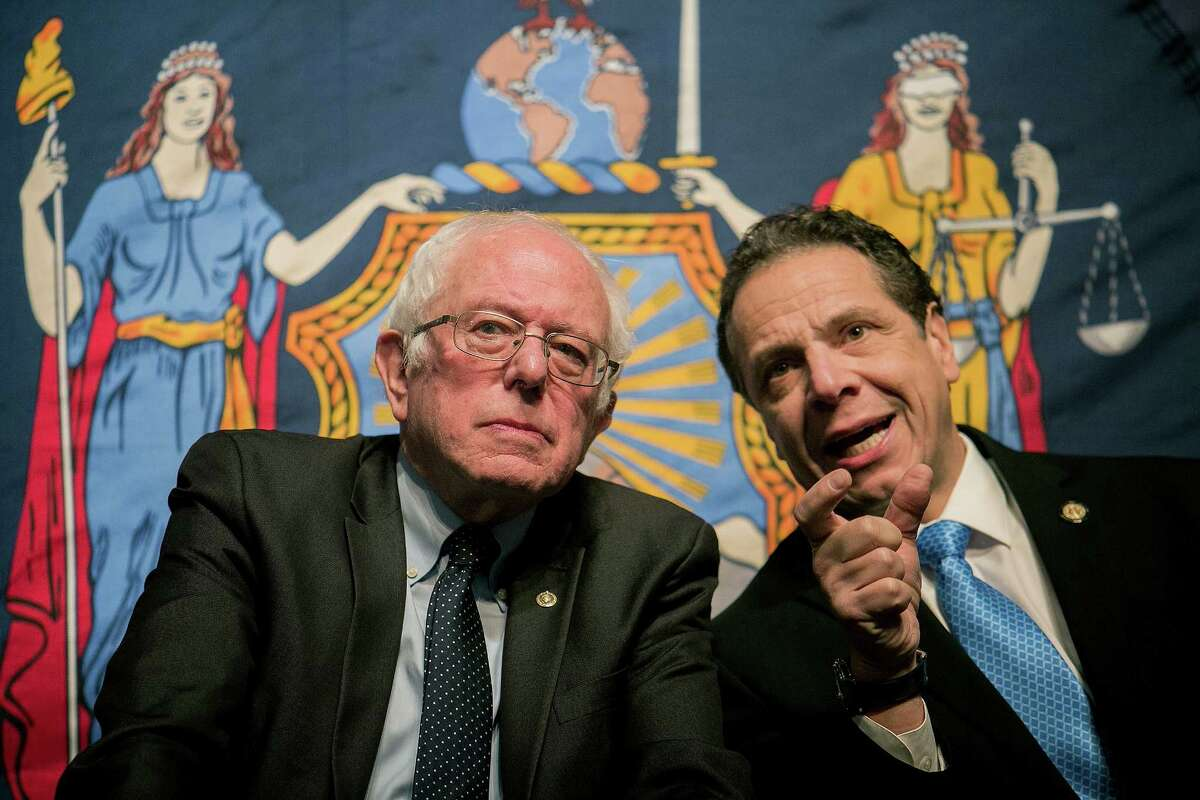 Sen. Bernie Sanders (I-Vt.) and New York Gov. Andrew Cuomo at LaGuardia Community College, where Cuomo unveiled a plan to provide free college tuition, in New York, Jan. 3, 2017. Under the plan, any college student who has been accepted to a state or city university in New York N including two-year community colleges N will be eligible provided they or their family earn $125,000 or less annually.