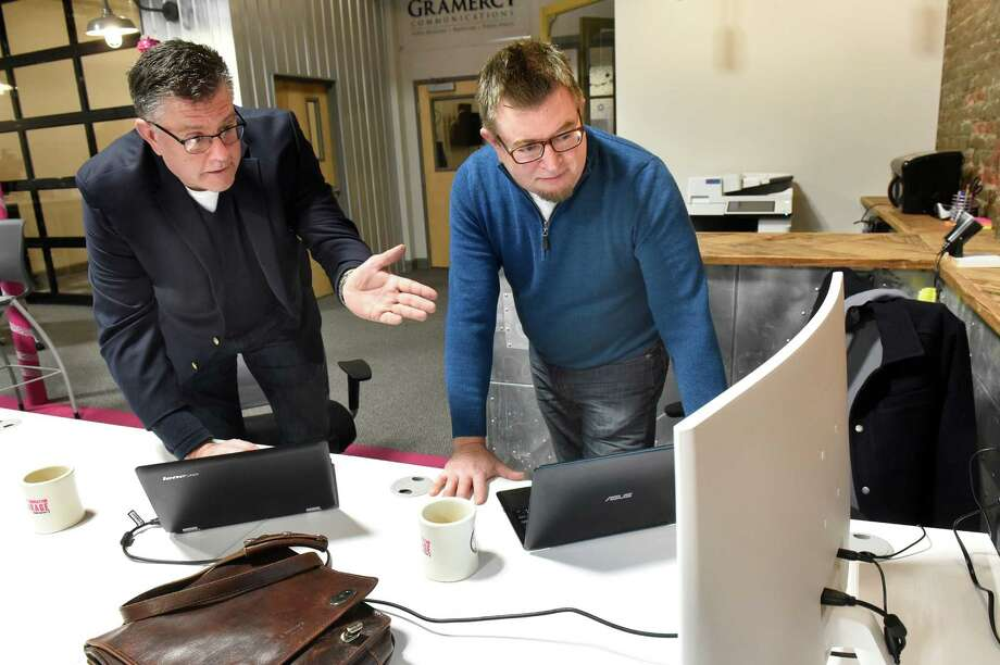 John Norris, left, and John Karling, co-owners of 5X5 Lab, talk about drmedpot.com, the website they created to locate medical marijuana doctors in New York, on Tuesday, Dec. 27, 2016, at the Troy Innovation Garage in Troy, N.Y. (Cindy Schultz / Times Union) Photo: Cindy Schultz / Albany Times Union