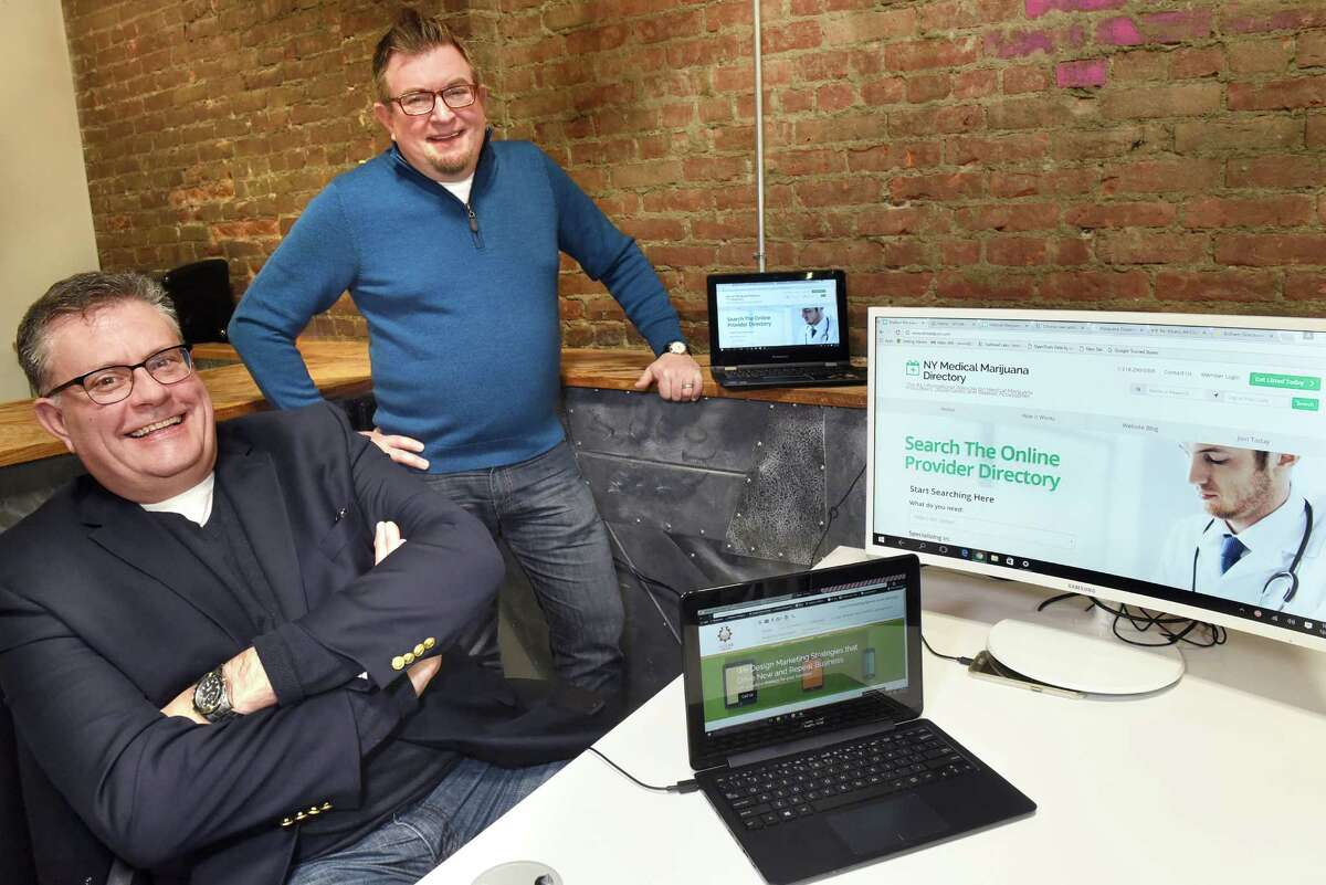 John Norris, left, and John Karling, co-owners of 5X5 Lab, talk about drmedpot.com, the website they created to locate medical marijuana doctors in New York, on Tuesday, Dec. 27, 2016, at the Troy Innovation Garage in Troy, N.Y. (Cindy Schultz / Times Union)