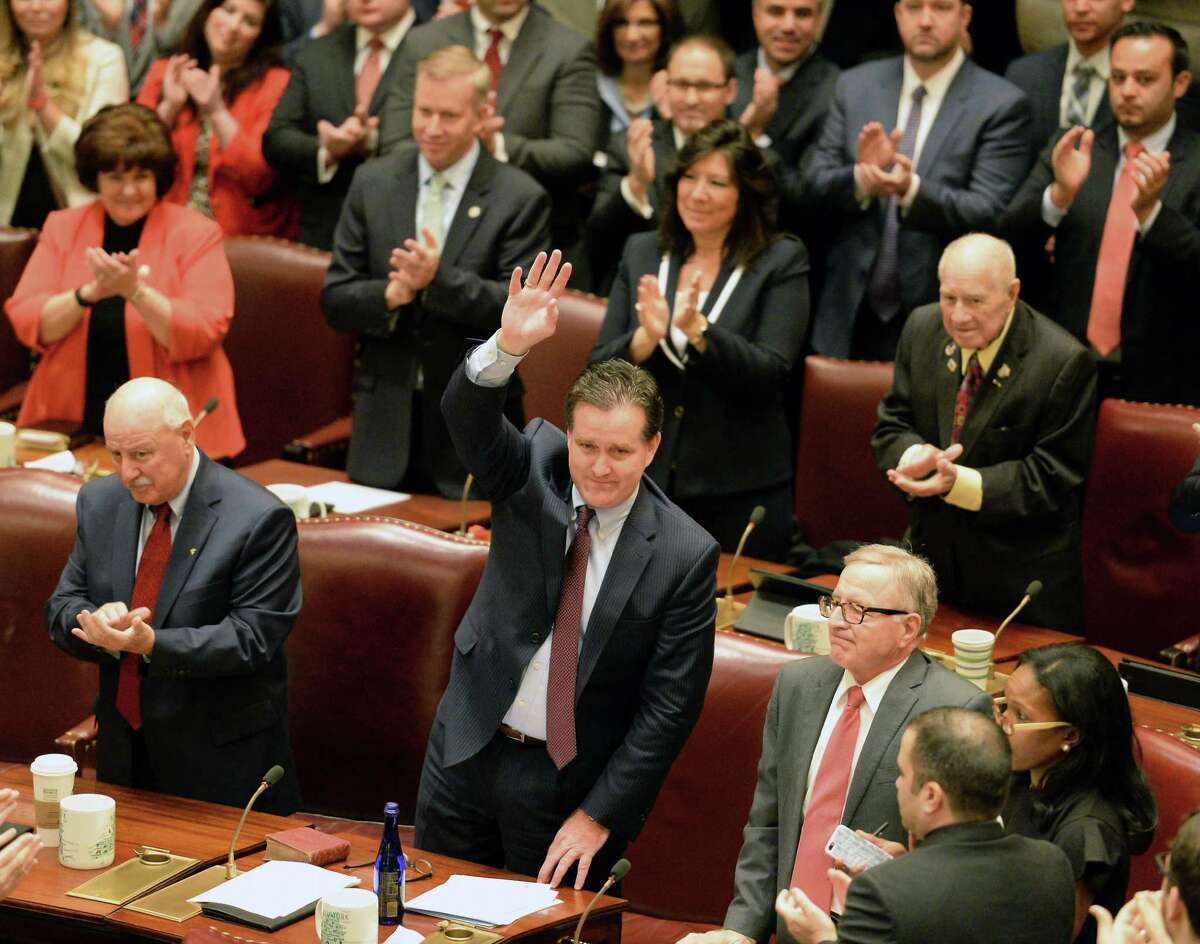 Senate Majority Leader John Flanagan, center, waves to supporters as he is reelected Majority Leader as the 2017 session of the NYS Legislature begins Wednesday Jan. 4, 2017 in Albany, NY. (John Carl D'Annibale / Times Union)