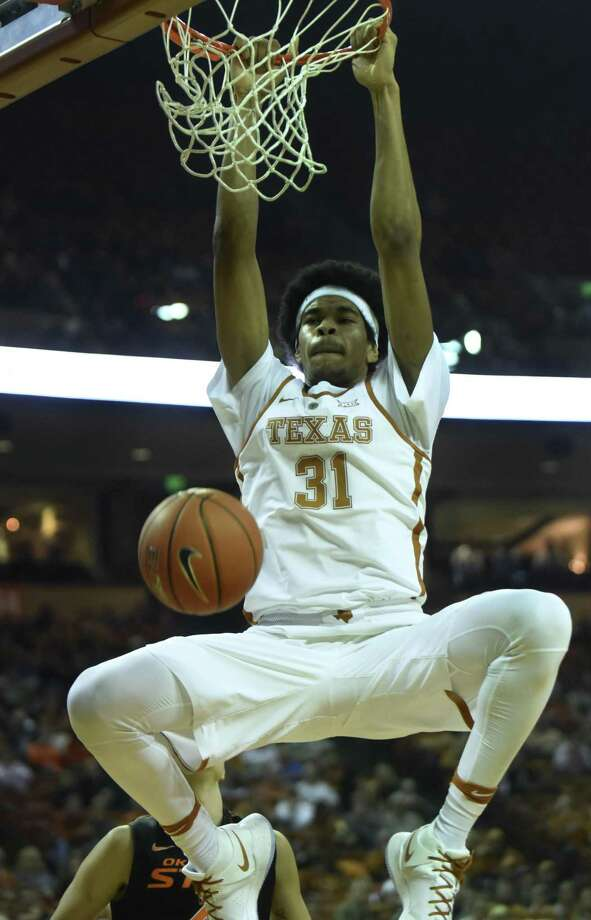 Jarrett Allen of Texas dunks against Oklahoma State during Big 12 action in Austin on Wednesday, Jan. 4, 2017. Photo: Billy Calzada, Staff / San Antonio Express-News