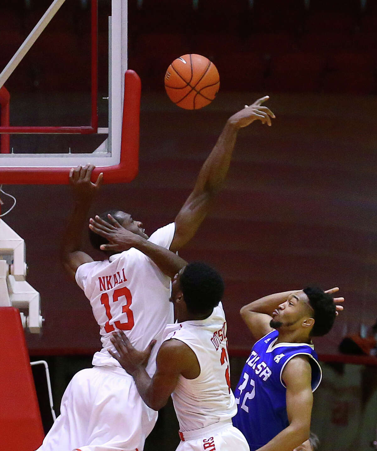 Houston Cougars forward Bertrand Nkali (13) blocks a shot by Tulsa Golden Hurricane forward Will Magnay (12) during the first half of a basketball game at Hofheinz Pavilion, on the University of Houston campus, Wednesday, Jan. 4, 2017, in Houston. ( Jon Shapley / Houston Chronicle )
