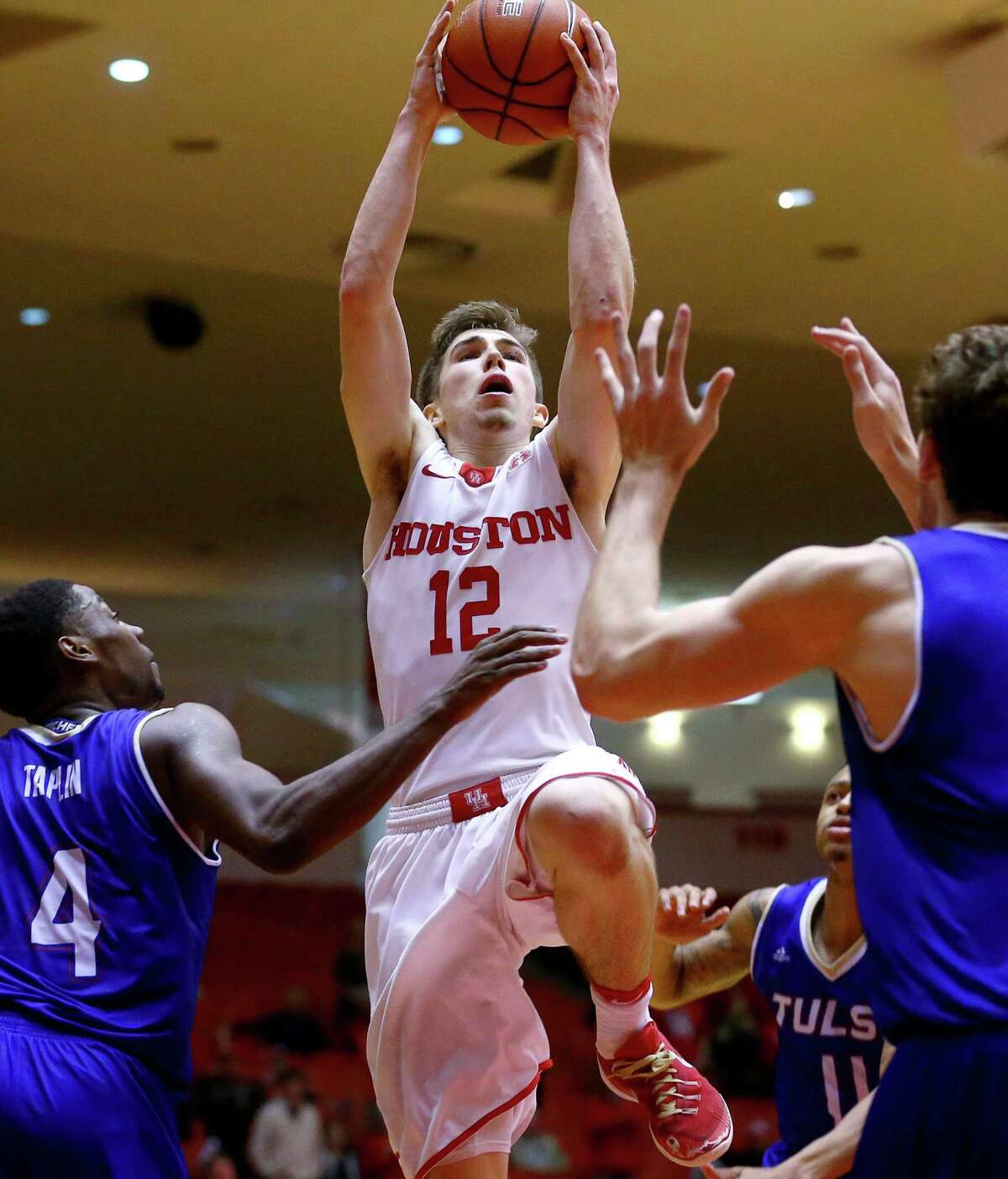 UH guard Wes Van Beck, who had 16 points while starting in place of the ill Rob Gray, goes to the basket in the second half Wednesday night.