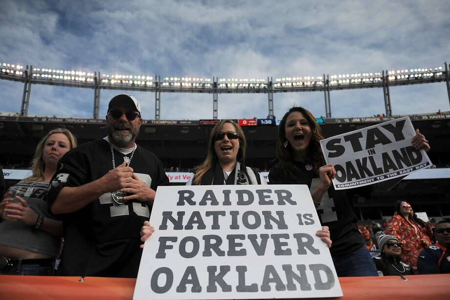 Oakland Raiders fans hold signs before the game against the Denver Broncos at Sports Authority Field at Mile High on January 1, 2017 in Denver, Colorado. (Photo by Dustin Bradford/Getty Images) Photo: Dustin Bradford, Getty Images