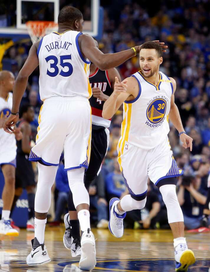 Golden State Warriors' Stephen Curry celebrates 4th quarter basket with Kevin Durant against Portland Trail Blazers during NBA game at Oracle Arena in Oakland, Calif., on Wednesday, January 4, 2017. Photo: Scott Strazzante, The Chronicle