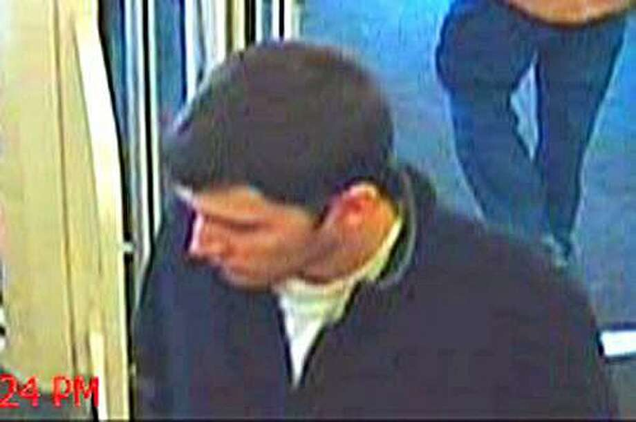 State and Southbury police are looking for a man who stole a wallet from an unlocked car parked in Ballantine Park on Dec. 27, 2016. The man, seen in surveillance photos, later used a credit card in the stolen wallet at the Southbury CVS. Photo: /
