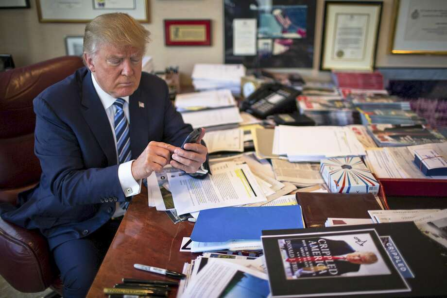 FILE-- Donald Trump demonstrates his tweeting skills in his office at Trump Tower in New York, Sept. 29, 2015. China's leaders thought they had a solution to the torrent of snark, jibes and condemnation on Twitter: They banned access to it at home. Yet in a twist, China has become the country that the now President-elect seems to enjoy criticizing the most on his open-all-hours Twitter feed. (Josh Haner/The New York Times) Photo: JOSH HANER, NYT