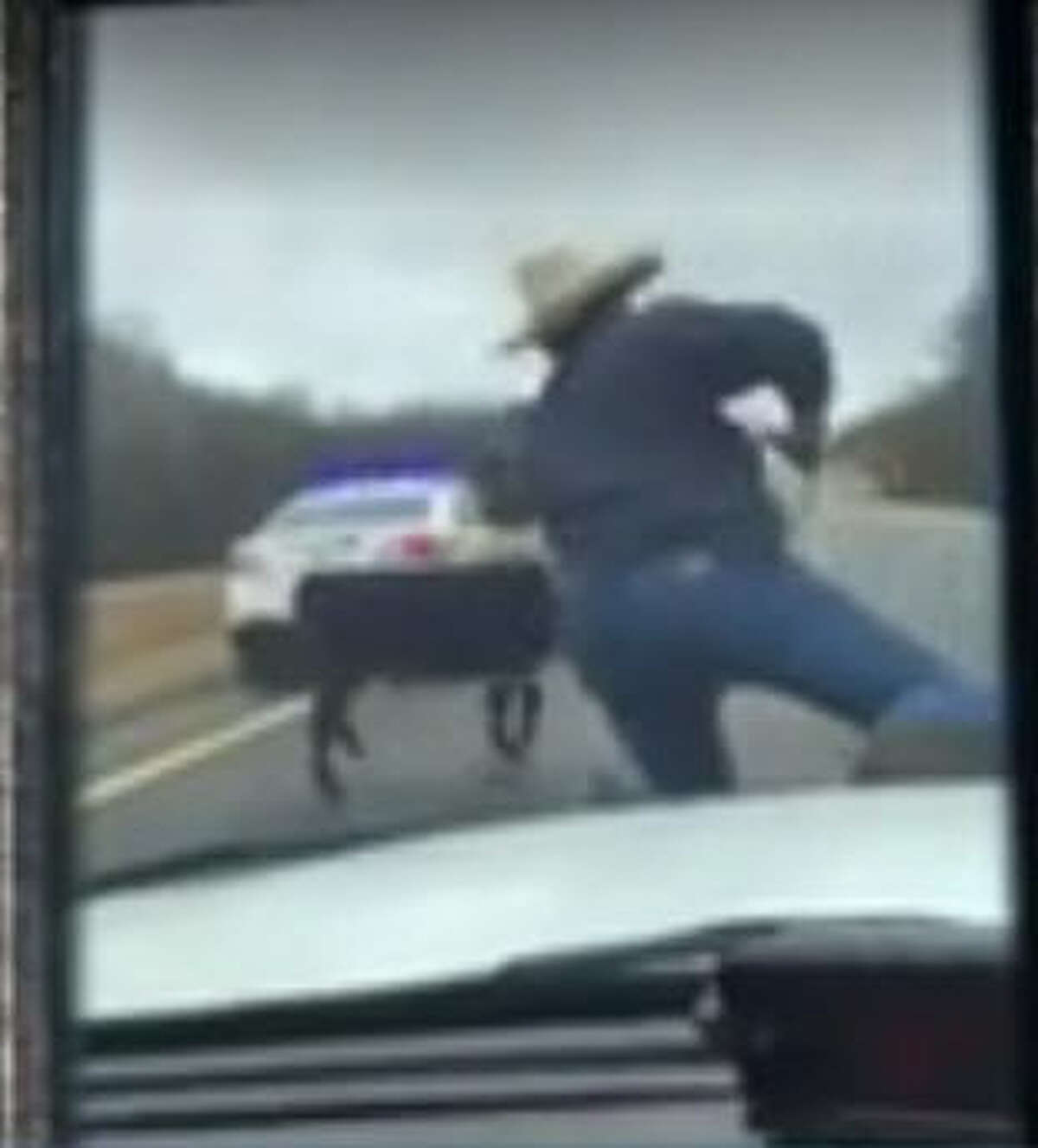 When a calf got loose on Highway 79 in rural Henry County, Tenn., the local sheriff asked a cowboy friend to lasso it, riding on the hood of the sheriff's car, Tuesday, Jan. 3, 2017. (NewsChannel5.com)