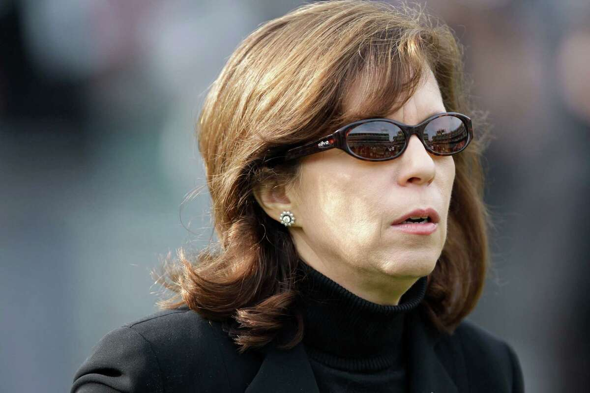 In this Nov. 27, 2011, photo, Oakland Raiders CEO Amy Trask stands on the sideline before the Raiders' NFL football game against the Chicago Bears in Oakland, Calif. Trask has resigned from the team. Trask says she told owner Mark Davis of her decision to leave the franchise on Saturday, May 11, 2013. Trask had been with the Raiders for 25 seasons and was one of the highest-ranking women in American professional sports. (AP Photo/Paul Sakuma)