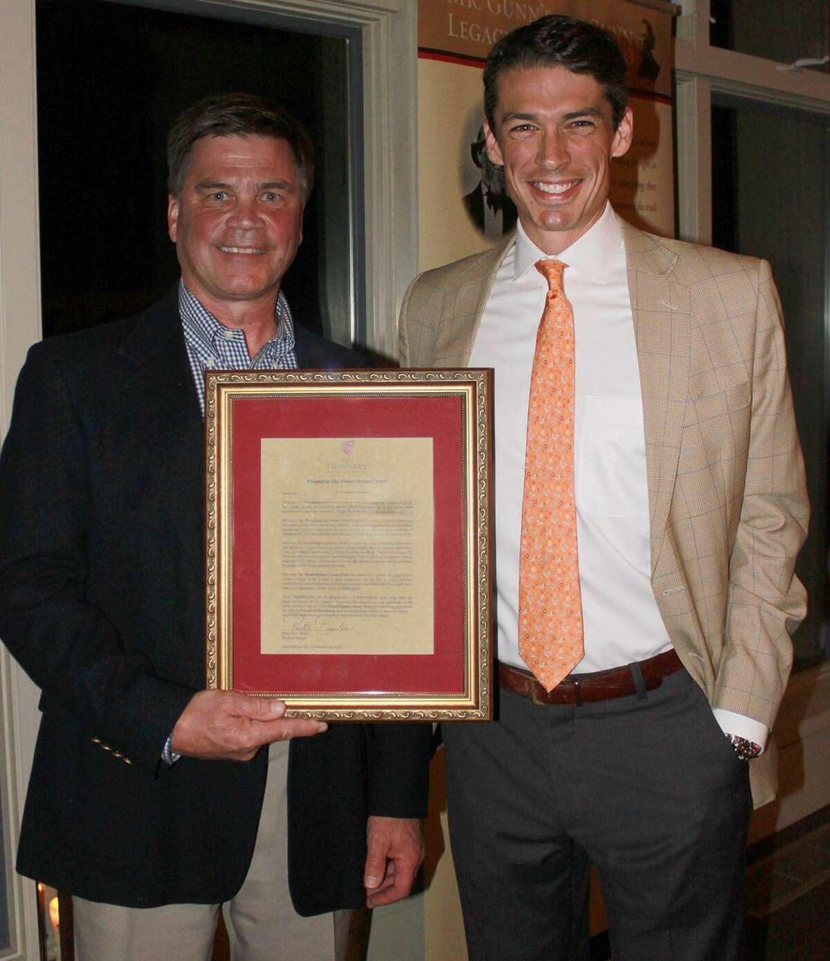The Washington Lions Club was recently presented the Gunnery's Friend of the Green Award. Above, John Quist, president of the Washington Lions Club, left, receives the award from Head of School Peter Becker.