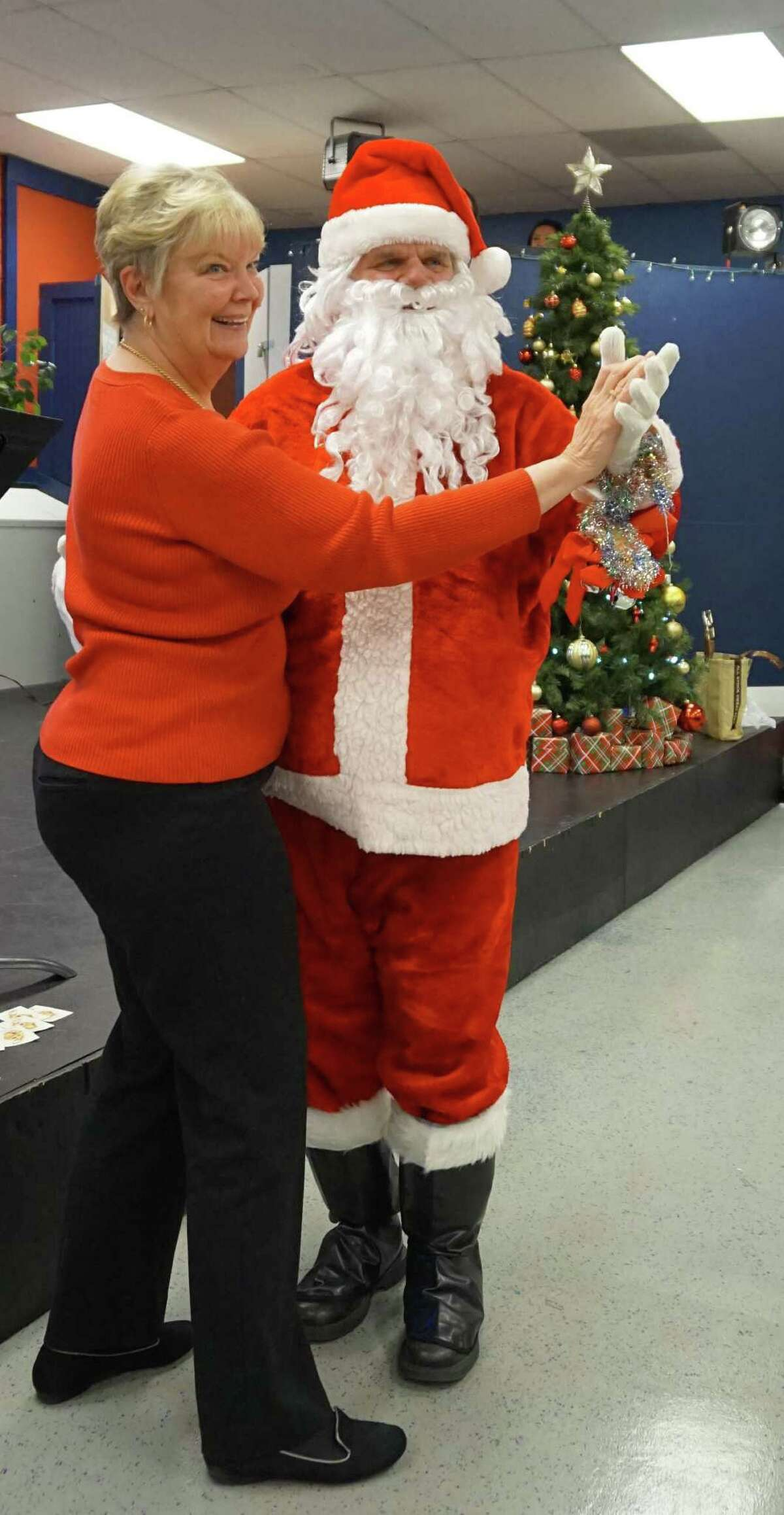 Phyllis Scarpone takes to the floor for a dance with Santa, a task she chose in order to win her door prize at the New Milford Senior Center's holiday celebration held earlier this month at The Maxx in New Milford.