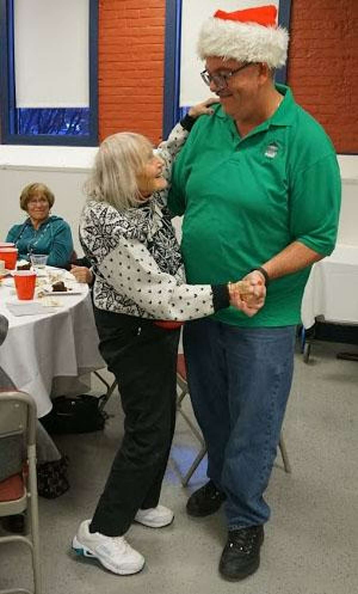 Muriel Gold and Tom Williams, a bus driver at the New Milford Senior Center, show off their dance skills at the center's holiday celebration at The Maxx.