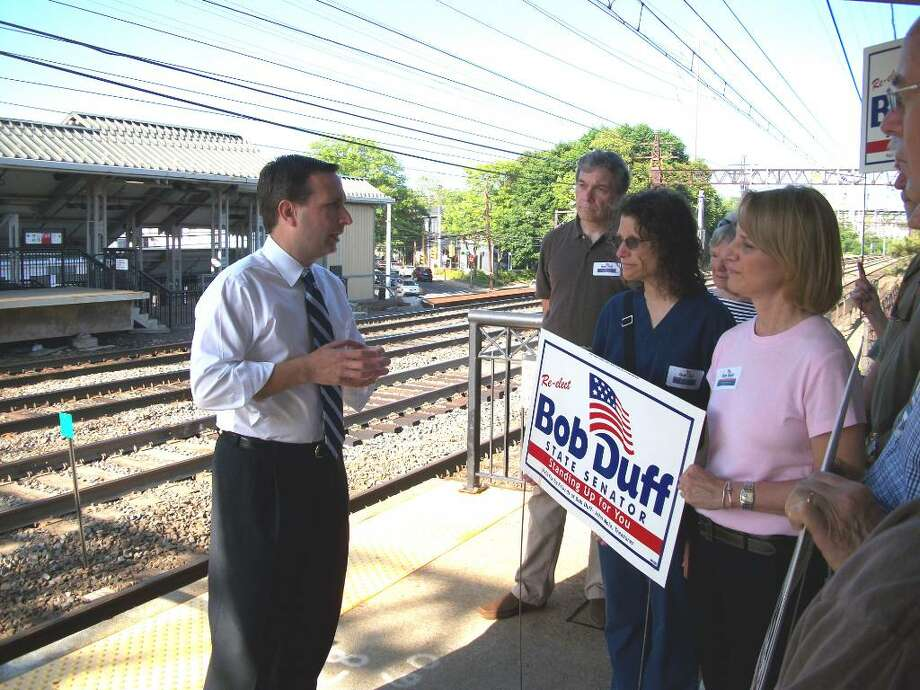 State Sen. Bob Duff addresses a group of about 10 people, including Darien's Democratic Former First Selectman Evonne Klein at the Darien Train Station on Monday afternoon. Photo: Maggie Gordon / Darien News