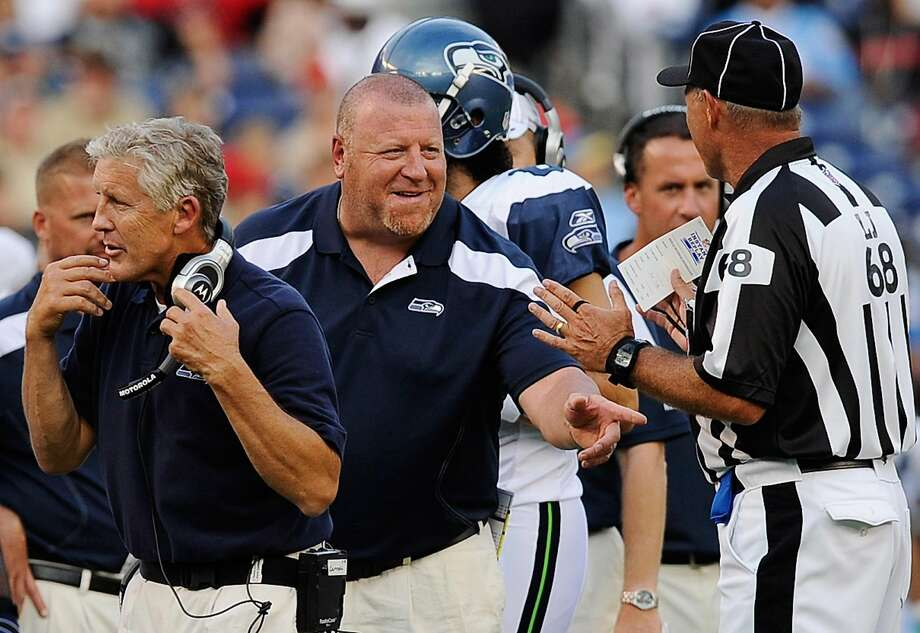 Seahawks offensive line coach Tom Cable (center) had a 17-27 record with the Raiders from 2008-10. Photo: Kevork Djansezian, Getty Images
