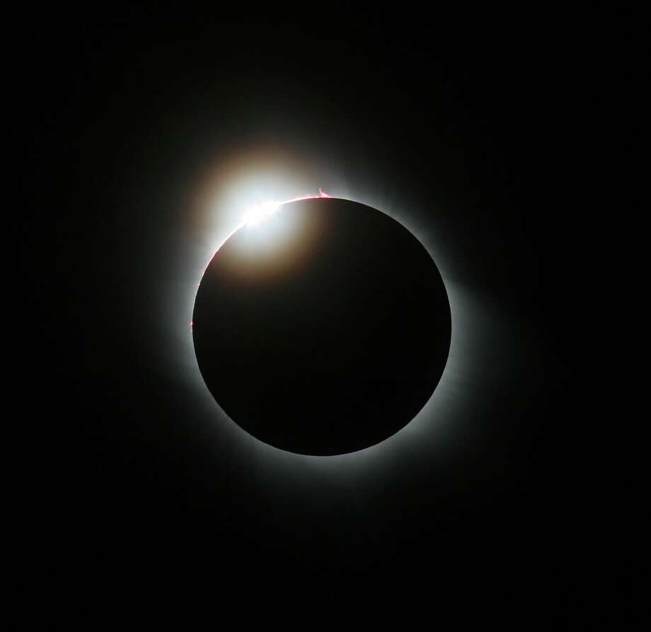 "For the first time in a century, the U.S. will experience a ""total solar eclipse."" Click through the slideshow to see photos from a solar eclipse in Australia in 2012. Photo: Jamie Cooper/SSPL Via Getty Images"
