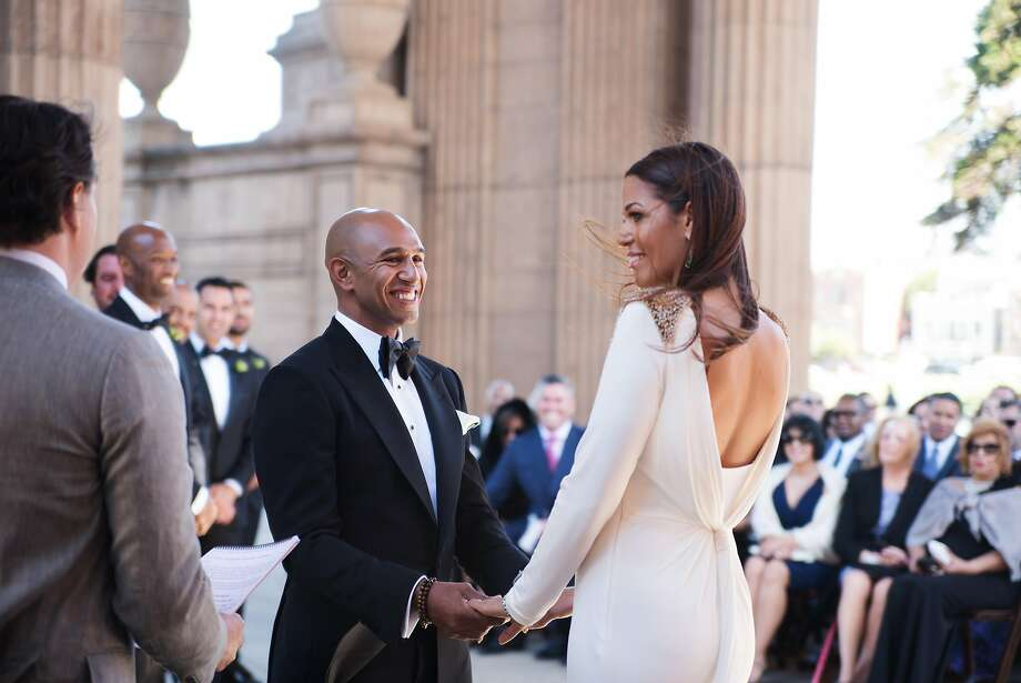 Andrea McBride and Fabian John were married in June at San Francisco's Palace of Fine Arts. The two shared vows in front of 144 guests from 19 different countries, but deliberately kept their promises private. Photo: Amina Touray Photography
