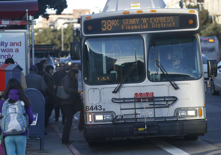 Commuters board a Muni 38-Geary Express bus at Geary Boulevard and 25th Avenue in San Francisco, Calif. on Thursday, Jan. 5, 2017. Photo: Paul Chinn, The Chronicle