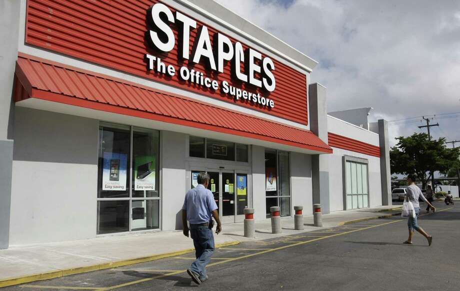 The United States Postal Service has agreed to curb a controversial arrangement allowing private employees to provide its services at Staples Inc. stores. Photo: Associated Press /File Photo / AP