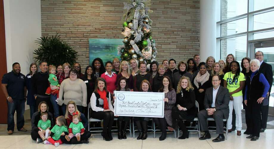 The Fort Bend Junior Service League recently announced the Sugar Plum Market presented by FBJSL and Memorial Hermann, raising $310,000. The proceeds were presented to Fort Bend County charities on Dec. 9 at a check presentation party held at Memorial Hermann Sugar Land. Photo: Submitted Photo
