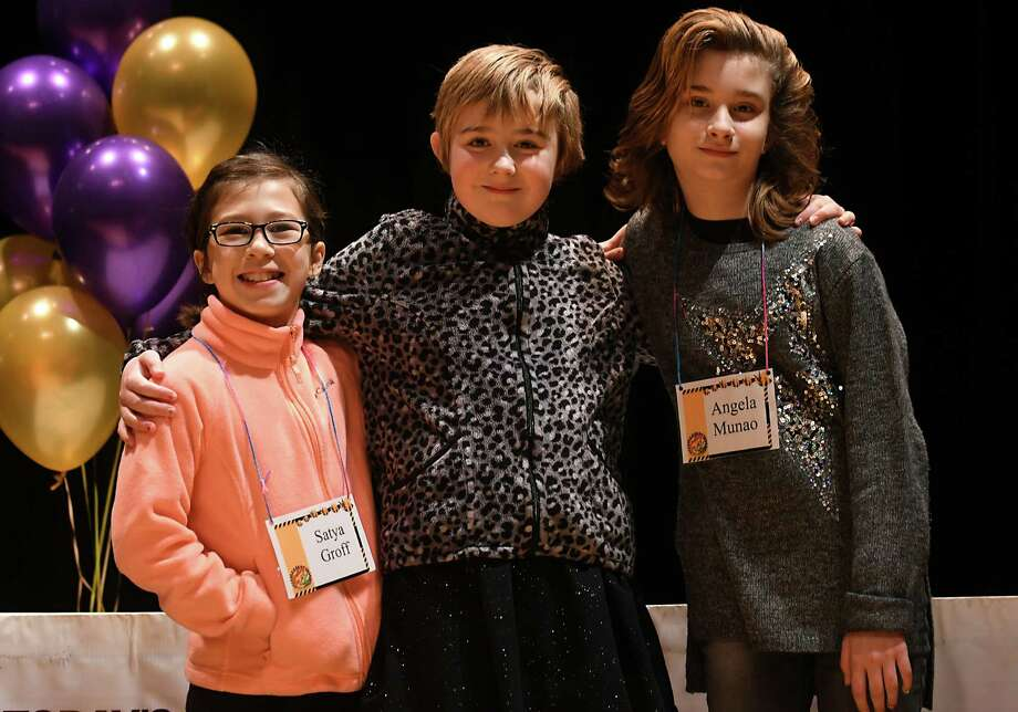 The three winners of the 2017 Troy CSD Spelling BEE, from left in order of first to third place; Satya Groff, 10, of School 14, Elisabeth McDonald, 10, of School 18 and Angela Munao, 12, of Troy Middle School, stand on stage at Veterans Memorial Auditorium on Thursday, Jan. 5, 2017, in Troy, N.Y. The three will advance to the Capital Region Spelling Bee at Proctors Theatre in February. (Lori Van Buren / Times Union) Photo: Lori Van Buren / 20039326A