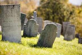 Old gravestones on a hillside cemetary.