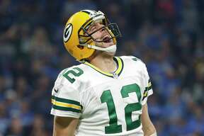 Green Bay Packers quarterback Aaron Rodgers reacts after a 9-yard pass to wide receiver Davante Adams for a touchdown during the second half of an NFL football game against the Detroit Lions, Sunday, Jan. 1, 2017, in Detroit. (AP Photo/Paul Sancya)