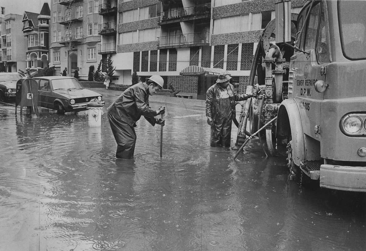 March 16, 1977: Flooded street, caused by a clogged sewer drain at Franklin and Pacific Streets in San Francisco. Photo by Robert Kaufman.